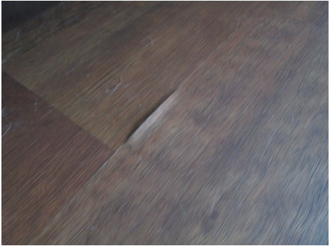 Forensic Floors - Buckling and Swelling Edges of Laminate